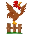 Cute rooster cartoon crowing on the fence vector image