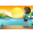 A boy watching the sunset vector image