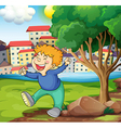 A happy young boy near the tree vector image