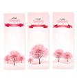 Three spring banners with blossoming sakura trees vector image