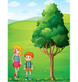 A tall girl with her brother at the hilltop vector image