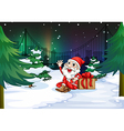 A smiling Santa beside the gift vector image vector image
