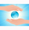 World in human hands vector image