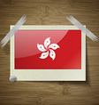 Flags Hong Kong at frame on wooden texture vector image
