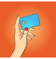 hand drawn pop art of hand holding credit card vector image