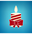 Colorful Christmas Candle on a Blue Background vector image