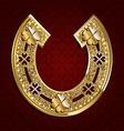 Golden horseshoe on a dark background vector image