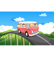 A school bus with kids travelling vector image vector image