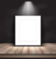 blank picture leaning against chalkboard vector image
