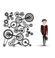 successful young businessman in suit with cogs - vector image