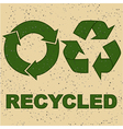 Recycling sign on recycled paper vector image