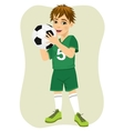 Cute teenager boy holding soccer ball vector image