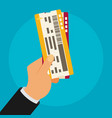 hand holding boarding pass tickets vector image