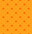 Orange seamless polka dots pattern with pumpkin vector image