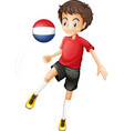 A man using the ball with the flag of Netherlands vector image