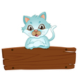 A beautiful cat leaning over the wooden signboard vector image