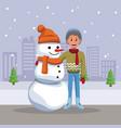boy with snowman cartoon vector image