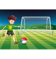 A young man kicking the ball with the flag of vector image