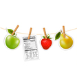 Fruit stickers and a nutrition label hanging on a vector image