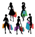 silhouettes of women with shopping bags vector image