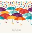 Autumn background with umbrellas in flat design vector image