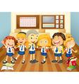 Children in uniform in the classroom vector image
