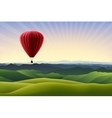 Mountain landscape with red air balloon vector image