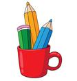pencils and mug vector image vector image