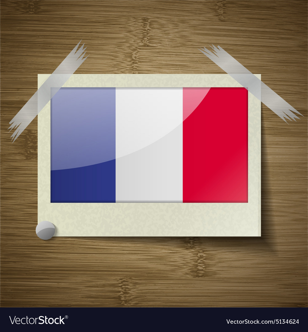 Flags frence at frame on wooden texture vector