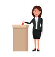 woman putting voting paper in the ballot box vector image