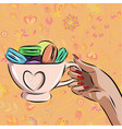 cup with different macaroons on background vector image