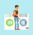 young woman choosing new clothes washer appliance vector image