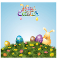 Easter Eggs and Bunny on Green Grass Hill vector image