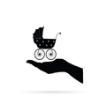 baby stroller in hand black vector image