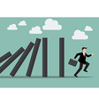 Businessman run away domino effect vector image