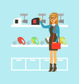 young blond woman choosing a meat grinder in home vector image