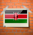Flags Kenya scotch taped to a red brick wall vector image