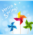 colorful pinwheels with blue sky spring poster vector image vector image