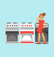 young woman choosing an electric stove in home vector image
