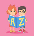 two caucasian kids studying with an abc-book vector image