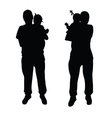 Father with baby silhouette vector image