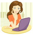Pretty young woman sitting with a laptop vector