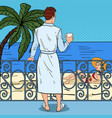 Man drinking coffee at the balcony pop art vector image