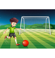 A young man kicking the ball with the flag of vector image vector image