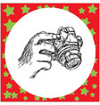 hand holding compact camera vector image