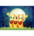 An amusement park with three happy monsters vector image vector image