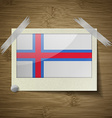 Flags Faroe Islands at frame on wooden texture vector image