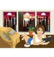 young woman reading ebook at home lying on floor vector image