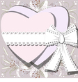 Two white hearts tied by ribbon with bow vector image