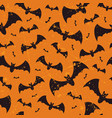 seamless halloween grunge pattern with bats vector image